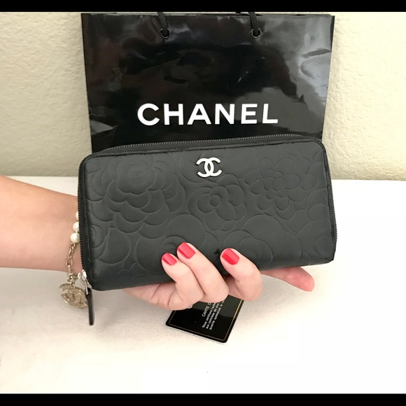 c3ed682d1d5b CHANEL Handbags - CHANEL Black Lambskin Camellia CC Zipped Wallet
